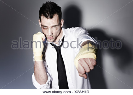 Man in a shirt boxing - Stock Photo