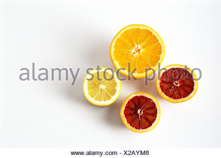 Sliced orange, blood orange, and lemon, close-up - Stock Photo