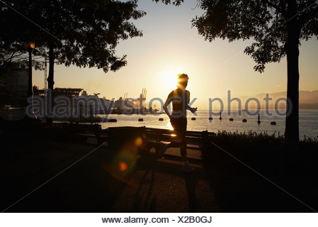 Person jogging along promenade, Canada - Stock Photo
