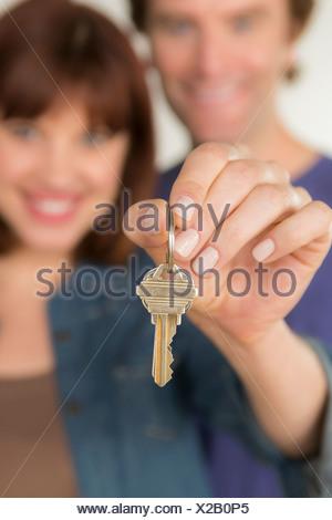 Couple holding new door key - Stock Photo