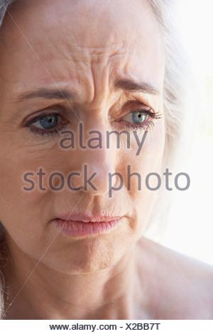 Portrait Of Senior Woman Looking Anxious - Stock Photo