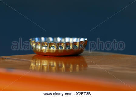 silver seal shutter mirrored huddled fasteners kronkorken flaschenverschluss - Stock Photo