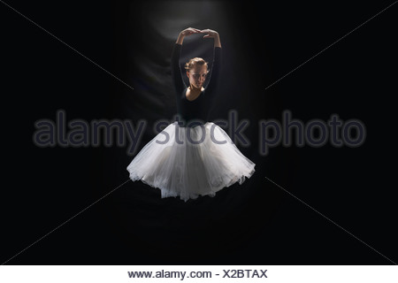 Ballerina on black background - Stock Photo