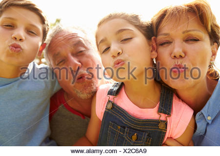 Portrait Of Grandparents And Grandchildren In Garden - Stock Photo