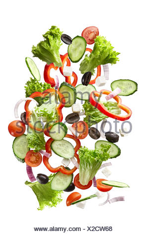 flying salad isolated on white background - Stock Photo