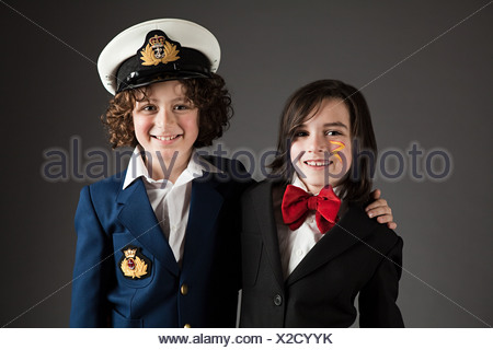 Young boys dressed up in sailor outfit and red bow tie - Stock Photo
