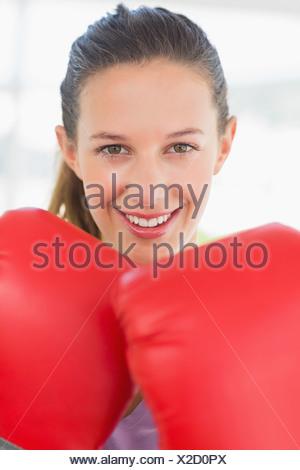 Closeup portrait of a smiling female boxer - Stock Photo