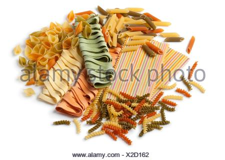 Variety of colorful traditional Italian pasta on white background. - Stock Photo