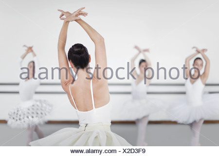 Ballet dancers posing in studio - Stock Photo