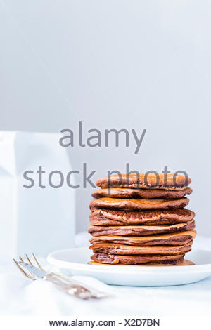 Stack of Eggless  Pancakes on a white plate . - Stock Photo