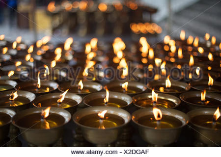 Burning Oil Lamps At A Temple - Stock Photo
