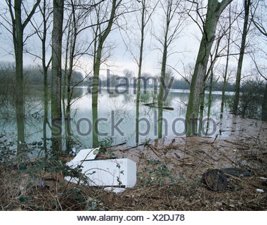 Refrigerator swept up in a flood plain, flotsam, flooding, CFC, CFCs - Stock Photo