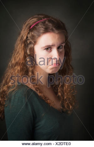 Portrait of a young woman with a sad face; United States of America - Stock Photo