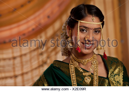 Portrait of young bride dressed up in Marathi style - Stock Photo