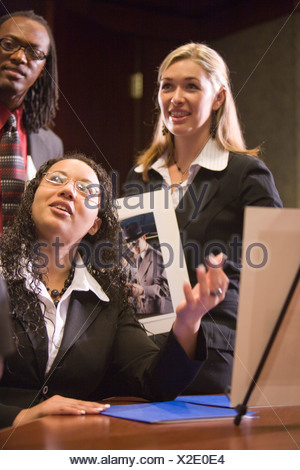 Multi-racial marketing team working on project in boardroom - Stock Photo
