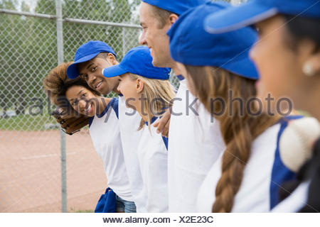 Baseball team standing together on field - Stock Photo