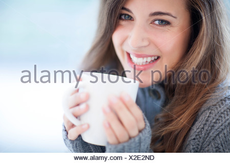 Woman with hot drink - Stock Photo