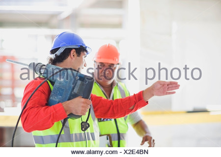 Workers with boring machine - Stock Photo