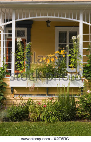 Old House Veranda With A Flower Box In Summer, Quebec, Canada   Stock Photo