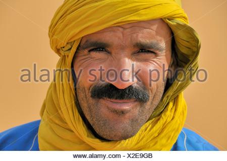 berber with traditional tagelmust , Morocco, Erg Chebbi, Sahara - Stock Photo