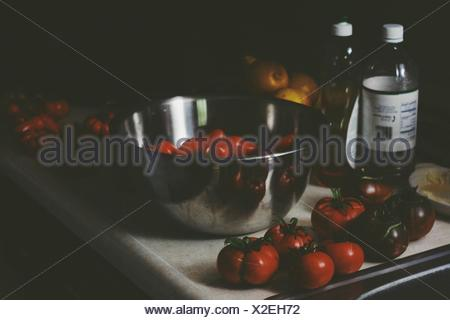 Tomatoes and red bell pepper lying on table - Stock Photo