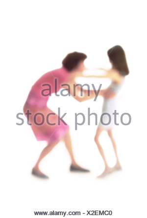 Silhouette of mother and daughter about to hug, on white background, defocused - Stock Photo