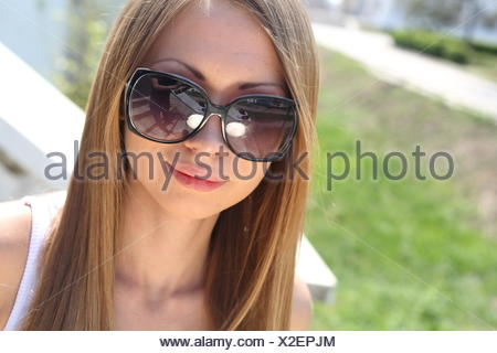 woman in jeans and dark glasses - Stock Photo