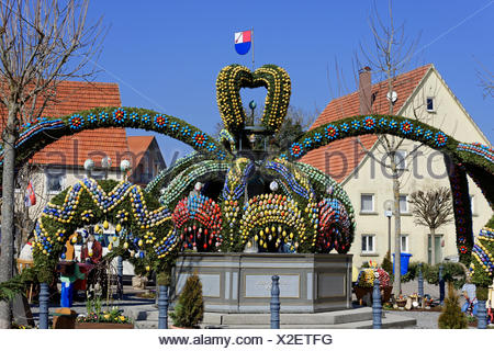 Easter well, Fountain decorated with easter eggs, Osterbrunnen, Schechingen, Baden-Württemberg, Germany - Stock Photo