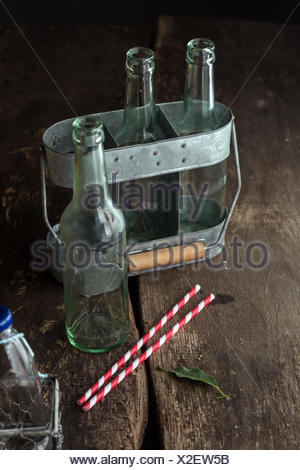 Empty Bottles in Tray Ready to Use for Any Liquids on Brown Wooden Table - Stock Photo