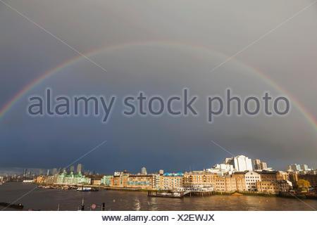England, London, Wapping, Rainbow over St.Katherine Dock - Stock Photo