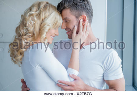 Loving couple enjoy a tender moment - Stock Photo