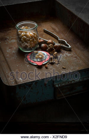 Home-made candied orange peel in jar in rustic decoration - Stock Photo