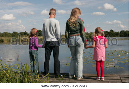 Back view of step siblings - Stock Photo
