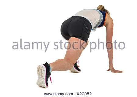 Female athlete in position ready to run - Stock Photo