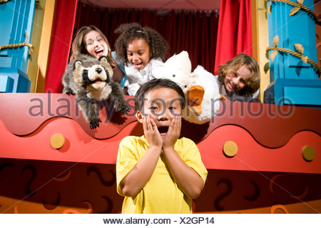 Asian school boy screaming with classmates and teacher in puppet theatre - Stock Photo