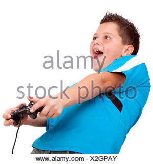 Teen boy playing with console - Stock Photo