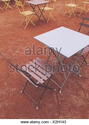 High Angle View Of Empty Chairs And Tables At Sidewalk Cafe - Stock Photo