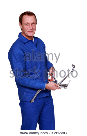 Plumber with tap - Stock Photo