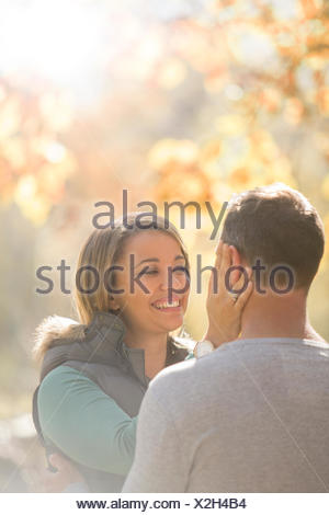 Affectionate couple hugging face to face - Stock Photo