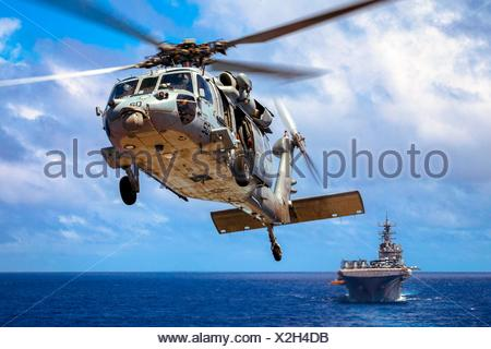 PACIFIC OCEAN (Sept. 12, 2016) A U. S. Navy MH-60S Seahawk from the USS Bonhomme Richard (LHD 6) maneuvers during a vertical replenishment at sea, - Stock Photo