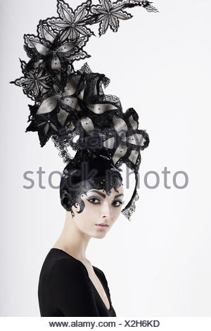 Stylish Eccentric Woman with Fanciful Make-up and Outlandish Hat