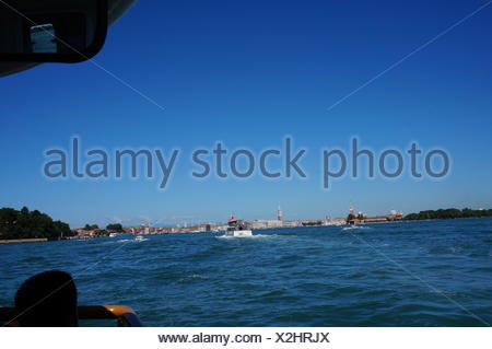 Boat Sailing In Lake Against Clear Blue Sky - Stock Photo
