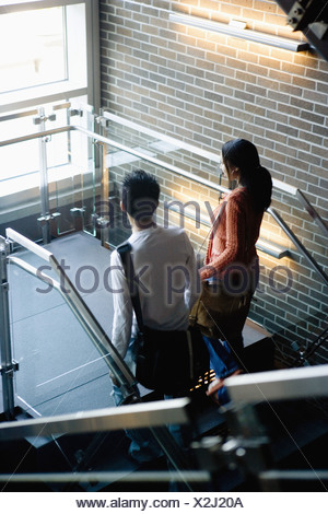 University students walking upstairs between classes - Stock Photo