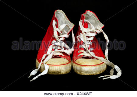 Worn red Chucks, sneakers - Stock Photo