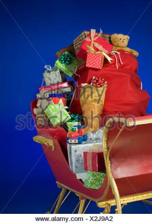 Sleigh with bag of Christmas toys - Stock Photo