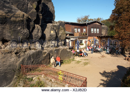Restaurant on the Nonnenfelsen rock, autumn landscape, sandstone and rock climbing, Jonsdorf the Zittauer Gebirge mountains - Stock Photo