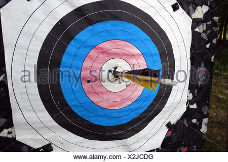 Berlin, Germany, Arrow is in the midst of a target - Stock Photo