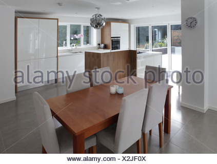 Dining table in open plan house - Stock Photo