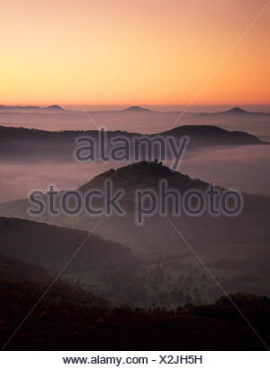 View from Breitenstein mountain across Limburg castle towards the three Kaiser mountains, near Weilheim, Swabian Alb - Stock Photo