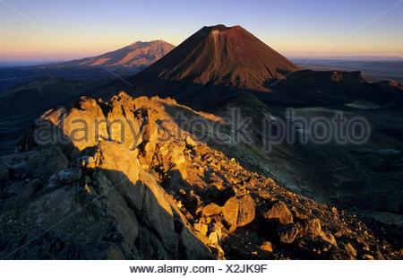 Mount Ngauruhoe and Mount Ruapehu, active volcanoes of the North Island of New Zealand, Tongariro National Park Ruapehu District - Stock Photo